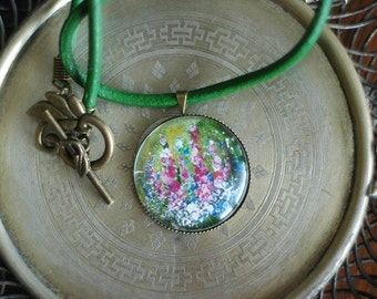 Necklace with hand painted flowers on the meadow