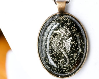 Oval seahorse in resin pendant on silver link chain