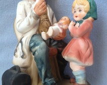 Doctor Figurine With Doll and Girl, Japan Porcelain Doctor Figurine, Physician Doc Dr. Statue, Asian Japan Pottery Art Medical Figurine