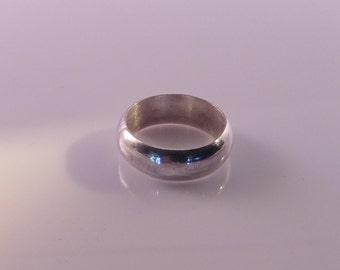 Tiny domed sterling silver band.