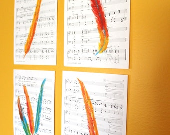 Original Paintings-Feathers on Sheet Music. Red, Blue, and Gold Scarlet Macaw Feathers, Collection of 4
