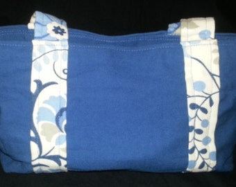 Blue purse with designed side stripes