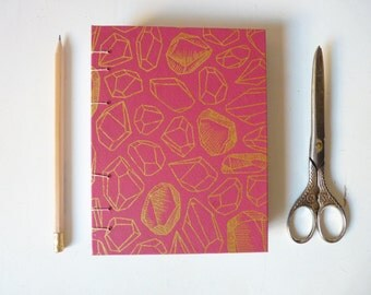 Fuchsia exposed spine coptic stitch medium journal with crystal silkscreen cover and white paper