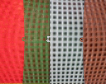 Plastic canvas, 8 sheets 7 ct, 2 red,2 green,2 lt. blue,2 brown