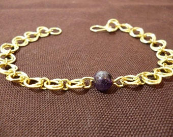"""Bracelet """"rings"""" in bronze with a natural Amethyst stone"""