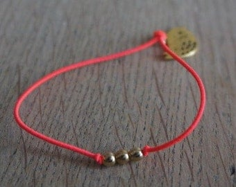 Cute bracelet with gold beads and little bird