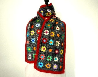 Crochet granny multicolored flowers on mottled grey scarf