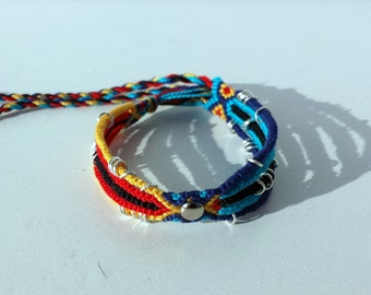 Knotted friendship bracelet with silver studs and links