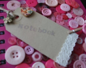Unique, hand decorated notebook using buttons.