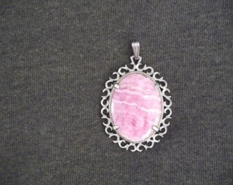 Victorian style Rhodochrosite pendant silver tone framed with braided loops. FREE SHIPPING