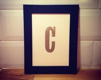 Framed gold letter C (letterpress print)