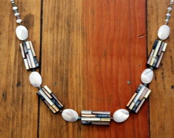 REDUCED!! Mother of pearl and bamboo style tiles set the stage for this stunning and unique necklace.