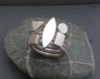 Set of 5 sterling silver geometric stacking rings, also available individually.