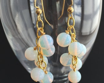 Dangling earrings of brilliant round opalite beads and gold-plate.