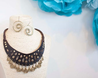 necklace of leather stamped with rivet color gold and spirals of life in brass...