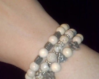 3 White Agate from Arizona beaded bracelets with textured pewter silver centerpiece beads.
