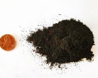 Ebony dust, powdered wood shavings, solid black