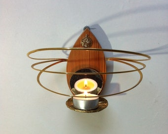 Hand crafted wall sconce made using found objects