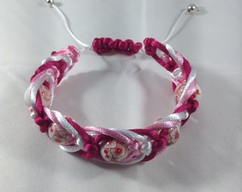 Red, pink and white herringbone design macramé with red and white beads