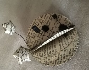 Brooch made of fragments of old books