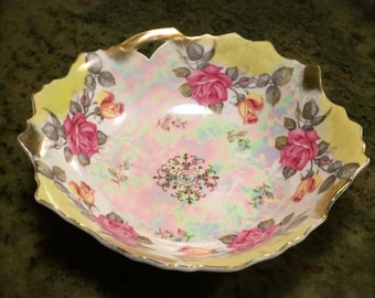 Prussian- look, pierced bowl with yellow and pink roses and gold trim