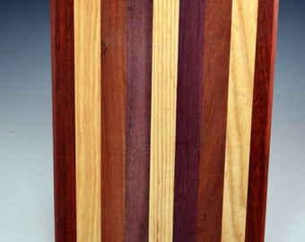 cutting board chop block trivet 12x 8.5.  This is the natural colors of the woods  which are paduck ash quina and purpleheart