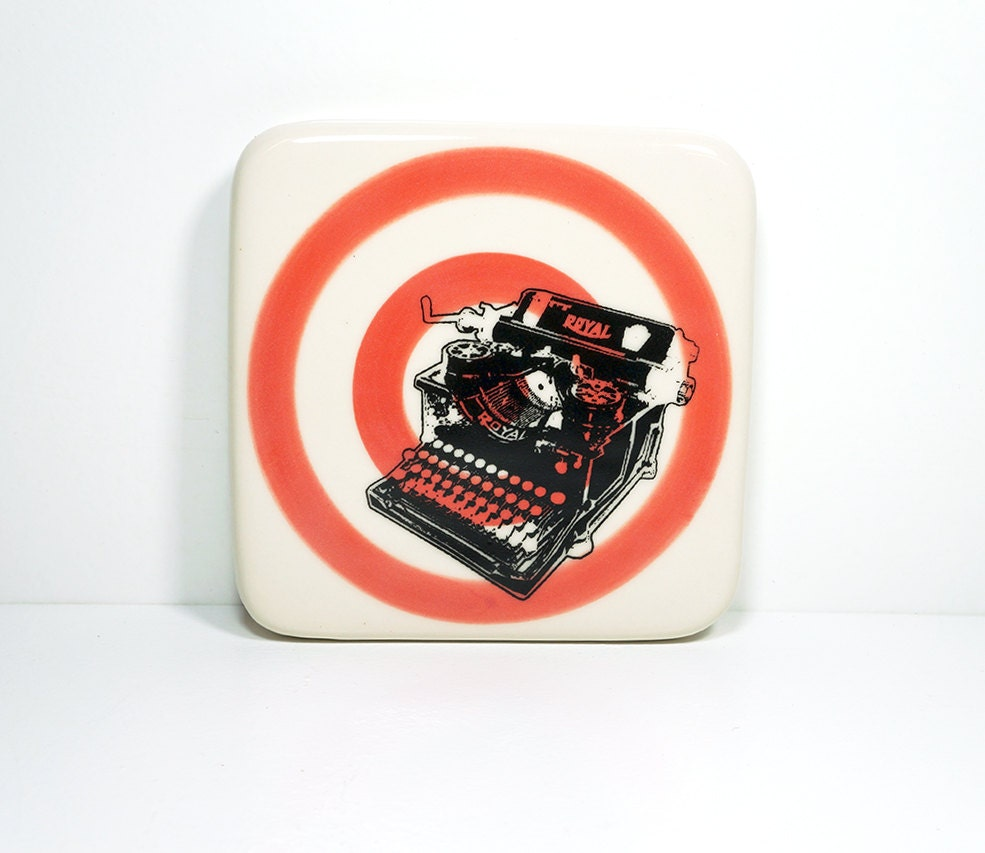 tile with a Royal typewriter on a red-orange bullseye, made to order.