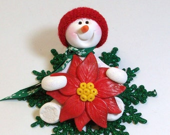 Snowman ornament with his favorite poinsettia flower