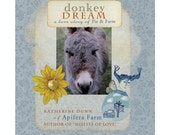 A printed hardcover book -Donkey Dream - A Love Story of Pie & Farm