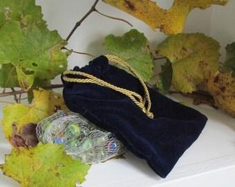 Marbles in a Blue Velvet Bag
