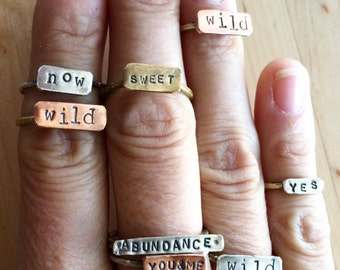 Custom handforged sterling silver mixed metal stacking poetry rings.