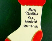 0032 Stocking with red trim.Message shown is a suggestion.This can be written with a message/name of your choice. All ornaments are dated