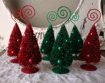 Bottle brush trees glittered Christmas place-card holders red and green Christmas table decor flocked trees