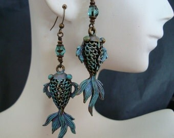 Lovely Iridescent Teal Filigree Earrings, Mysterious Creature of Symbolism, Gorgeous Flow and Form, Wire Wrapped Faceted Czech Jeweled Bead