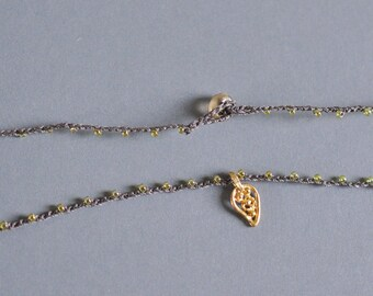 Tiny gold filigree leaf pendant on daintiest crocheted beaded necklace in brown