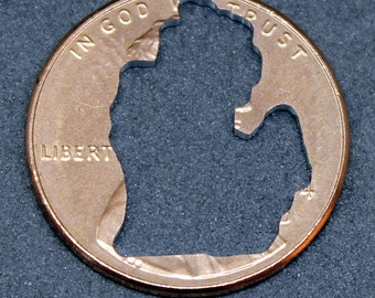 Lucky penny with Michigan cut out
