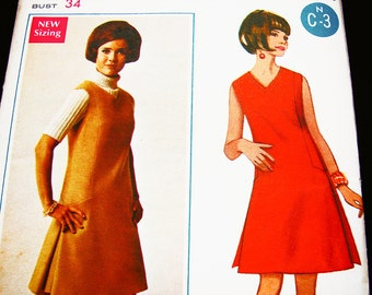1970s Jumper Dress Pattern UNCUT Misses size 12 Vintage Sewing Pattern Womens V Neck A line Dress or Jumper Pattern