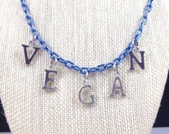 VEGAN necklace in silver letters with blue chain