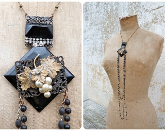 VENDANGES assemblage long sautoir necklace with black bucckles filigrees & grappes