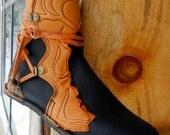 Handmade Leather Half Hawks.Black buffalo with deerskin trims and Italian embossed heel trim.Custom made or stocks sizes 5,6,7,8,9,10