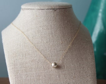 Free Domestic Shipping.  Simple and sweet dangling sterling silver round.