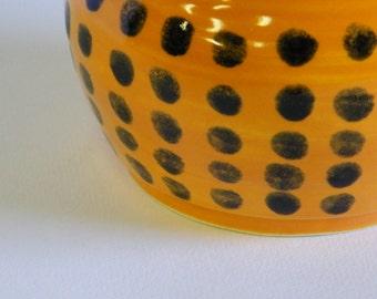 Orange Pot with Black Dot Pattern