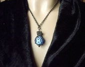 Pendant necklace, periwinkle blue matte glass with black filigree and chain
