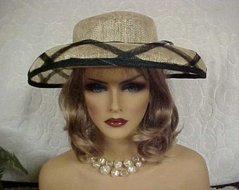 Natural straw hat with turned down brim and black crisscross trim fits 21 to 22 inches