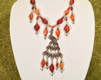 Peacock Necklace with Red Orange Brazilian Carnelian Agate, Swarovski Crystals, and Copper Finish Beads and Pendant