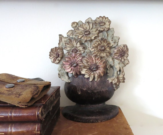 vintage cast iron door stop, floral doorstop, flower in a vase doorstop, antique iron doorstop, early door stop, flowers in a pot doorstop