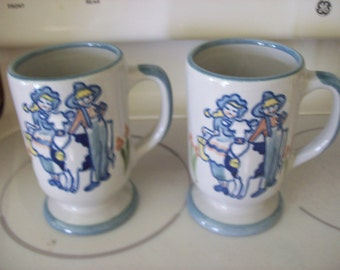 SALE Set of 2 Louisville Stoneware Mugs Made in USA Farmer Boy and Girl and Cow Was 18.00