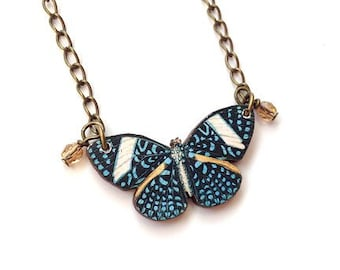 Butterfly necklace blue spotted wings with yellow, chain with crystal beads