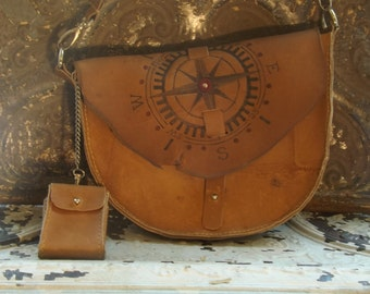 Rough and Rustic Leather Cross body Adventure bag with chained accessory wallet, unusual shape