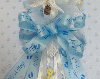 B1) A Boy Baby Sock Corsage with 'It's A Boy' Foot Print and Yellow Accents for a Baby Shower